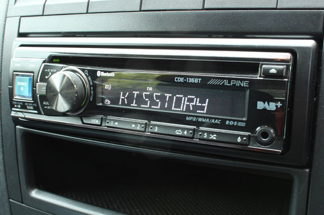 An in-dash DAB car radio tuned to Kisstory