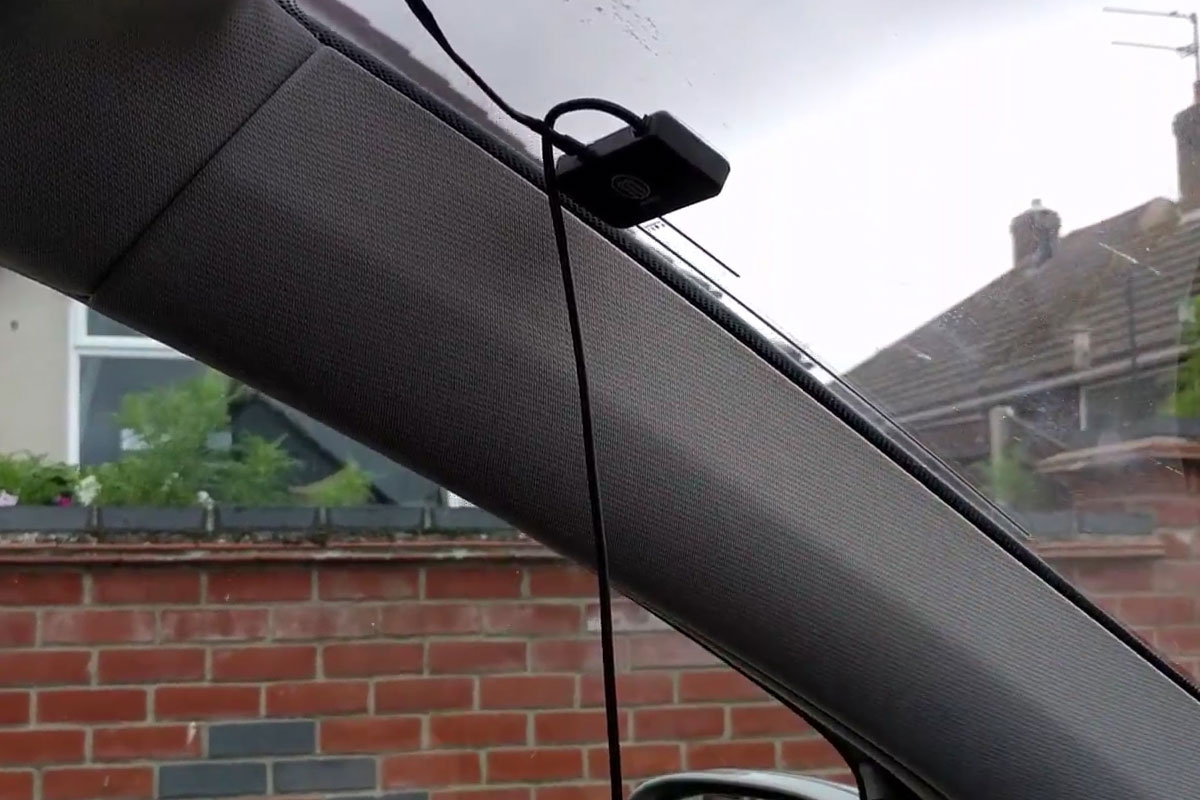 Install the film antenna on the windscreen
