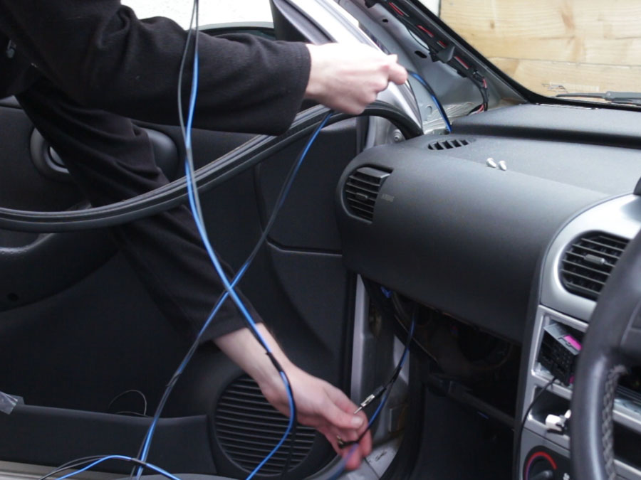 Feed the cables through the interior
