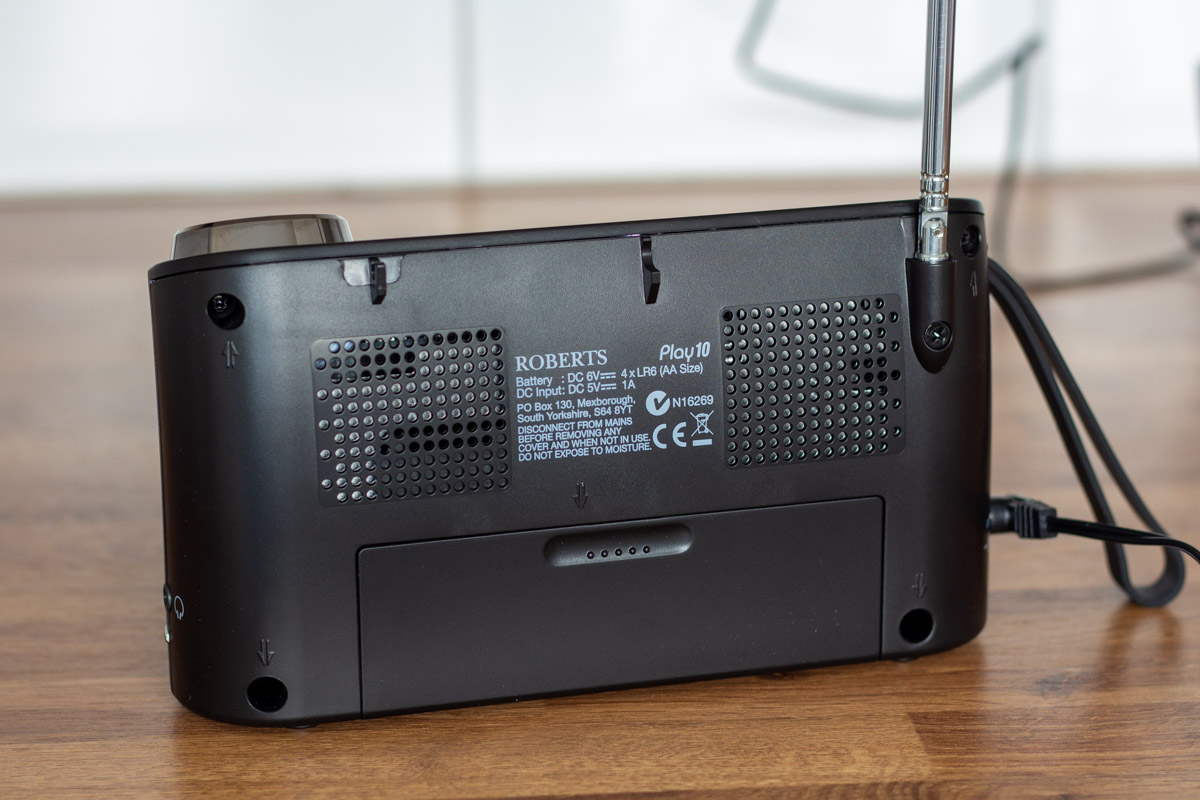 The rear of a Roberts Play 10 radio with battery compartment